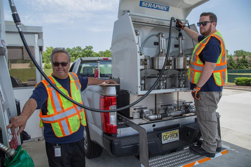 Monmouth County Weights & Measures staff testing gas pumps for accuracy.